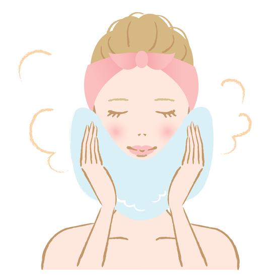 蒸しタオルで顔を包む女性